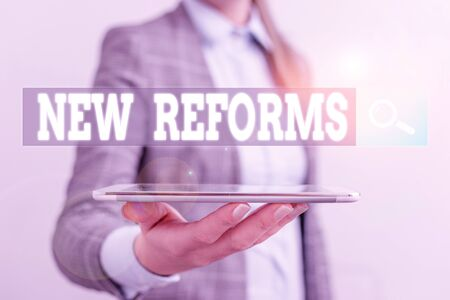 Writing note showing New Reforms. Business concept for to amend or improve by change of form or removal of faults Business concept with mobile phone and business woman
