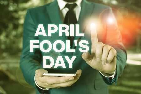 Conceptual hand writing showing April Fool S Day. Concept meaning Practical jokes humor pranks Celebration funny foolish Businessman with pointing finger in front of him