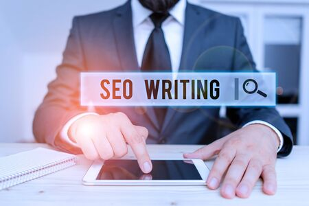Conceptual hand writing showing Seo Writing. Concept meaning grabbing the attention of the search engines using specific word Male human wear formal clothes present use hitech smartphone