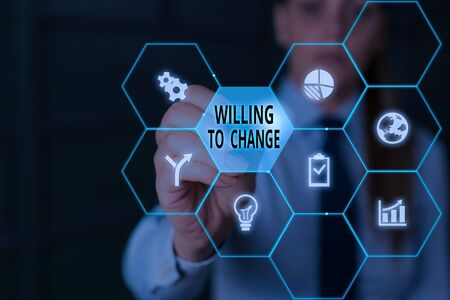 Writing note showing Willing To Change. Business concept for Desire to grow Eager to accept and adopt new ideas Stock Photo