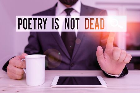Text sign showing Poetry Is Not Dead. Business photo showcasing aesthetic and rhythmic writing is still alive and modern Male human wear formal clothes present presentation use hi tech smartphone Zdjęcie Seryjne - 134176817