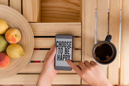Writing note showing Choose To Be Happy. Business concept for Decide being in a good mood smiley cheerful glad enjoy woman with laptop smartphone and office supplies technology Stockfoto