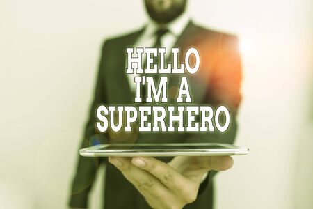 Word writing text Hello I M A Superhero. Business photo showcasing Believing in yourself Selfconfidence Introduction Male human wear formal work suit hold smart hi tech smartphone use one hand