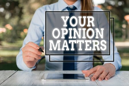 Text sign showing Your Opinion Matters. Business photo showcasing to Have your say Providing a Valuable Input to Improve Female business person sitting by table and holding mobile phone