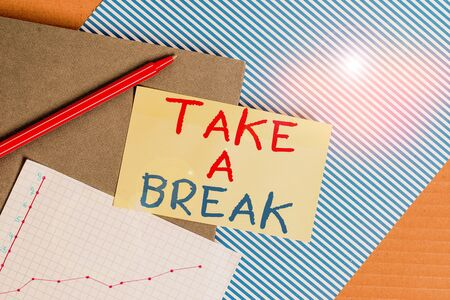Conceptual hand writing showing Take A Break. Concept meaning Resting Stop doing something recreation time get out of work Striped paperboard cardboard office study supplies chart