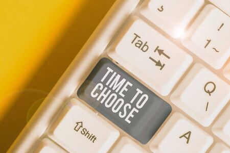 Conceptual hand writing showing Time To Choose. Concept meaning Judging the merits of multiple options and selecting one White pc keyboard with note paper above the white background