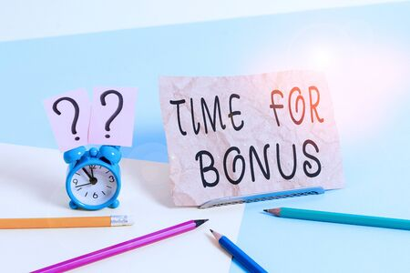 Conceptual hand writing showing Time For Bonus. Concept meaning a sum of money added to a demonstrating s is wages as a reward Mini size alarm clock beside stationary on pastel backdrop
