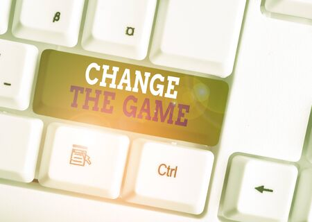 Word writing text Change The Game. Business photo showcasing Make a movement do something different new strategies White pc keyboard with empty note paper above white background key copy space