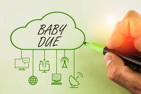 Escritura a mano conceptual mostrando Baby Due. Concepto Significado acerca de nacer bajo compromiso en cuanto al tiempo que se espera que esté listo Foto de archivo