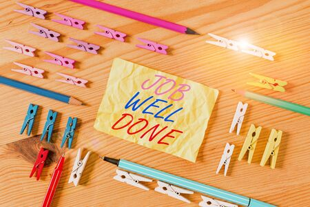 Text sign showing Job Well Done. Business photo showcasing Well Performed You did it Cheers Approval Par Accomplished Colored clothespin papers empty reminder wooden floor background office
