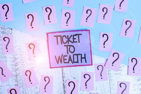 Handwriting text Ticket To Wealth. Conceptual photo Wheel of fortune Passage to Successful and brighter future Scribbled and crumbling papers with thick cardboard above wooden table