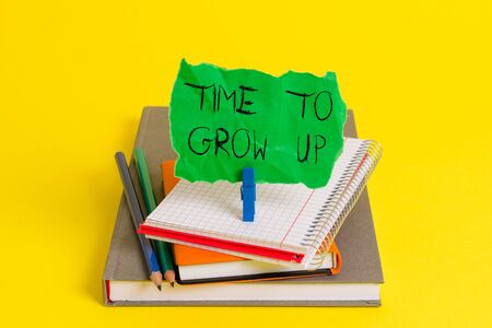 Text sign showing Time To Grow Up. Business photo showcasing knowing that you are mature demonstrating have responsibility Book pencil rectangle shaped reminder notebook clothespin office supplies
