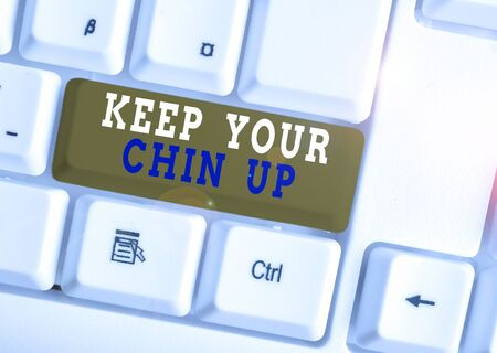 Word writing text Keep Your Chin Up. Business photo showcasing Remain cheerful in difficult circumstances High Spirit White pc keyboard with empty note paper above white background key copy space