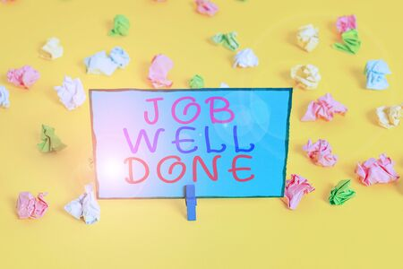 Text sign showing Job Well Done. Business photo showcasing Well Performed You did it Cheers Approval Par Accomplished Colored crumpled papers empty reminder white floor background clothespin
