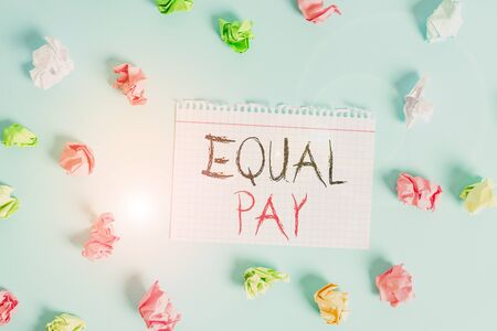 Word writing text Equal Pay. Business photo showcasing Rights that individuals in the same workplace be given equal pay Colored crumpled rectangle shaped reminder paper light blue background