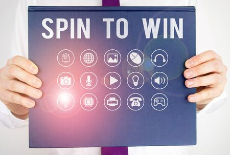 Text sign showing Spin To Win. Business photo showcasing Try your luck Fortune Casino Gambling Lottery Games Risk Stock Photo