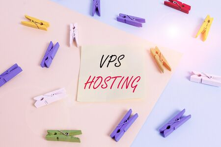 Word writing text Vps Hosting. Business photo showcasing mimics a dedicated server within a shared hosting environment Colored clothespin paper empty reminder yellow blue floor background office