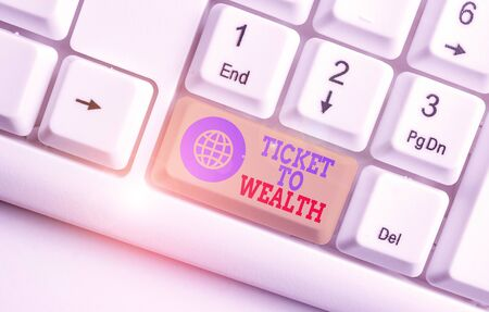 Conceptual hand writing showing Ticket To Wealth. Concept meaning Wheel of fortune Passage to Successful and brighter future White pc keyboard with note paper above the white background
