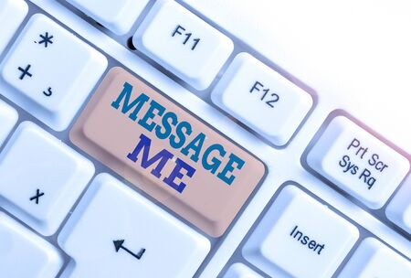 Handwriting text writing Message Me. Conceptual photo To ask someone to send you a short text from one mobile device White pc keyboard with empty note paper above white background key copy space