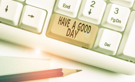 Word writing text Have A Good Day. Business photo showcasing Nice gesture positive wishes Greeting Enjoy Be happy White pc keyboard with empty note paper above white background key copy space