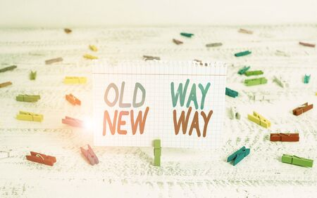 Handwriting text writing Old Way New Way. Conceptual photo The different way to fulfill the desired purposes Green clothespin white wood background colored paper reminder office supply
