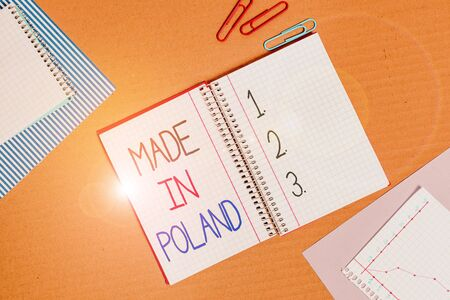 Conceptual hand writing showing Made In Poland. Concept meaning A product or something that is analysisufactured in Poland Striped paperboard cardboard office study supplies chart