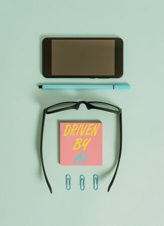 Word writing text Driven By A1. Business photo showcasing Move or controlled by a top quality driver in the society Dark eyeglasses colored sticky note smartphone pen clips pastel background