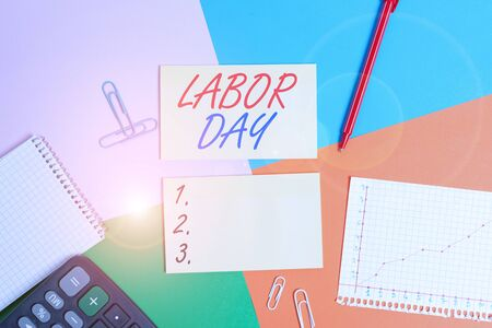 Conceptual hand writing showing Labor Day. Concept meaning an annual holiday to celebrate the achievements of workers Office appliance square desk study supplies paper sticker