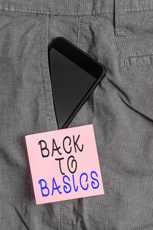 Handwriting text Back To Basics. Conceptual photo Return simple things Fundamental Essential Primary basis Smartphone device inside formal work trousers front pocket near note paper