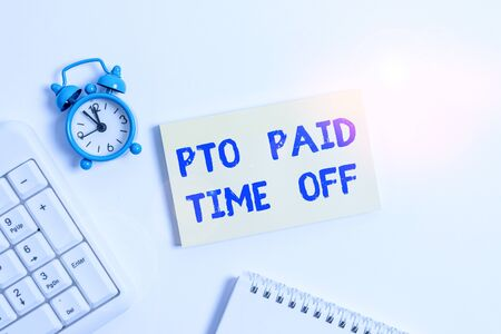 Conceptual hand writing showing Pto Paid Time Off. Concept meaning Employer grants compensation for demonstratingal holidays Keyboard with empty note paper and pencil white background