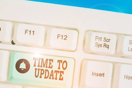 Writing note showing Time To Update. Business concept for The latest information about a particular situation