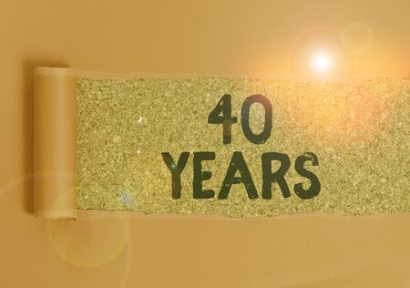 Text sign showing 40 Years. Business photo text Remembering or honoring special day for being 40 years in existence Cardboard which is torn in the middle placed above a wooden classic table 版權商用圖片