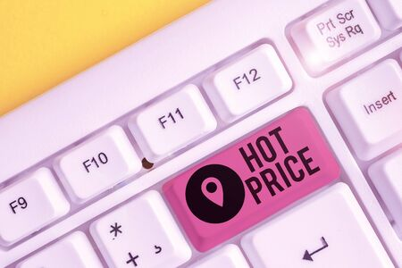 Writing note showing Hot Price. Business concept for Buyer or seller can obtain something for a product sold or buy White pc keyboard with note paper above the white background