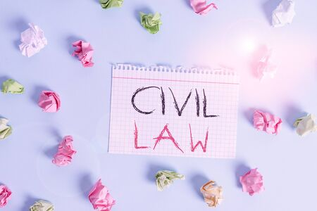 Word writing text Civil Law. Business photo showcasing Law concerned with private relations between members of community Colored crumpled rectangle shaped reminder paper light blue background