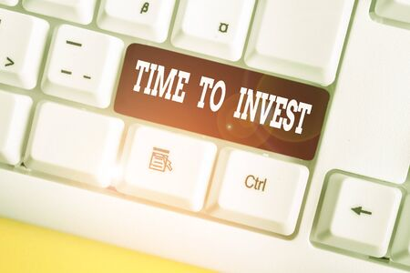 Word writing text Time To Invest. Business photo showcasing Creation of capital capable of producing other goods White pc keyboard with empty note paper above white background key copy space