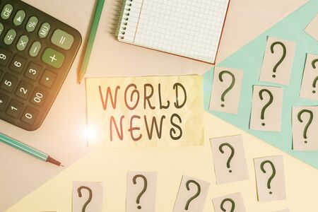 Writing note showing World News. Business concept for global noteworthy information about recent or important events Mathematics stuff and writing equipment above pastel colours background