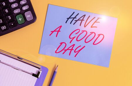 Writing note showing Have A Good Day. Business concept for Nice gesture positive wishes Greeting Enjoy Be happy Clipboard blank sheet square page calculator pencil colored background Banque d'images