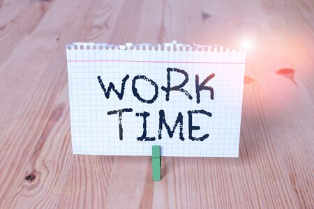Word writing text Work Time. Business photo showcasing period starts when temporary workers are engaged at a worksite Empty reminder wooden floor background green clothespin groove slot office