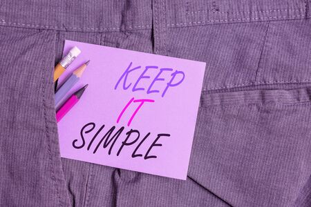 Writing note showing Keep It Simple. Business concept for Easy to toss around Understandable Generic terminology Writing equipment and purple note paper inside pocket of trousers