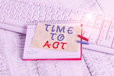 Conceptual hand writing showing Time To Act. Concept meaning Do it now Response Immediately Something need to be done notebook reminder clothespin with pinned sheet light wooden