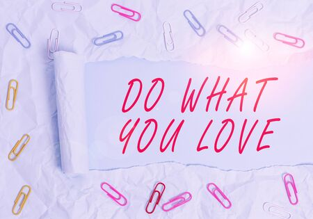 Text sign showing Do What You Love. Business photo text Make enjoyable things do activities with motivation Paper clip and torn cardboard placed above a plain pastel table backdrop