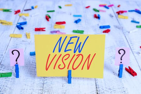 Writing note showing New Vision. Business concept for seeing some future developments Hopeful about the future Crumbling sheet with paper clips placed on the wooden table