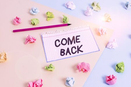 Word writing text Come Back. Business photo showcasing asking for a demonstrating to return place where love ones resides Colored crumpled papers empty reminder blue yellow background clothespin Stock Photo - 134302890