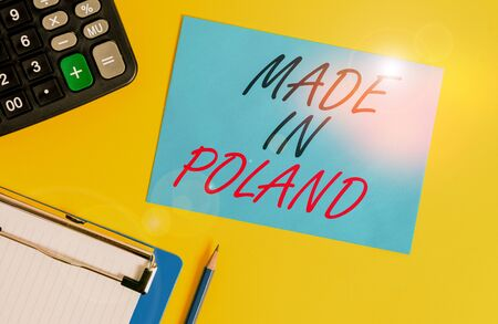 Writing note showing Made In Poland. Business concept for A product or something that is analysisufactured in Poland Clipboard blank sheet square page calculator pencil colored background Archivio Fotografico