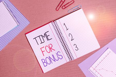 Conceptual hand writing showing Time For Bonus. Concept meaning a sum of money added to a demonstrating s is wages as a reward Striped paperboard cardboard office study supplies chart
