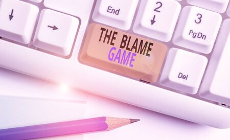 Word writing text The Blame Game. Business photo showcasing A situation when showing attempt to blame one another White pc keyboard with empty note paper above white background key copy space