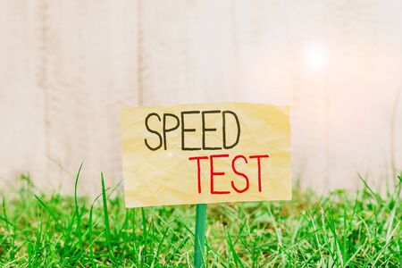 Handwriting text writing Speed Test. Conceptual photo psychological test for the maximum speed of performing a task Plain empty paper attached to a stick and placed in the green grassy land