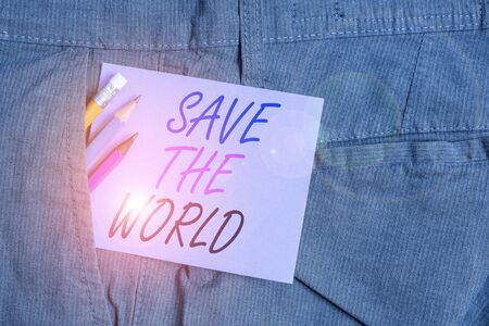 Writing note showing Save The World. Business concept for Protect the environment and the living species Ecosystem Writing equipment and purple note paper inside pocket of trousers Zdjęcie Seryjne - 134312371