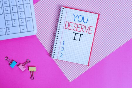 Word writing text You Deserve It. Business photo showcasing Reward for something well done Deserve Recognition award Writing equipments and computer stuffs placed above colored plain table Stock Photo