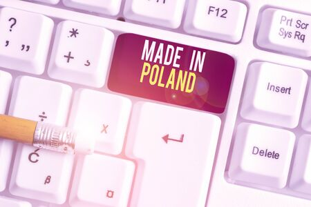 Text sign showing Made In Poland. Business photo text A product or something that is analysisufactured in Poland White pc keyboard with empty note paper above white background key copy space Archivio Fotografico